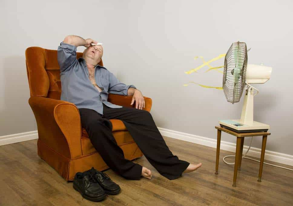 Guy Sweating in Chair with No AC